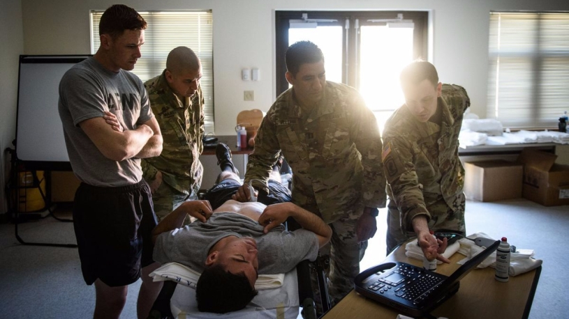 MAJ Jonathan Monti, EMPA, teaches medics in the 82nd Airborne Division how to use ultrasound.